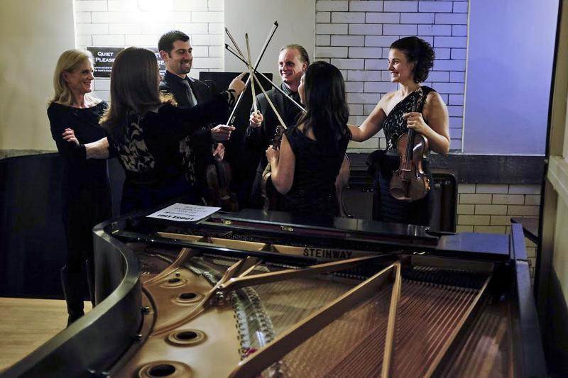 Pianist Simone Dinnerstein and the Chiara String Quartet backstage before their performance at the Library of Congress