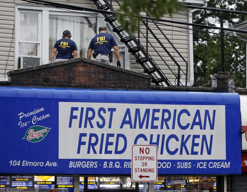FBI agents walk around the roof outside an apartment tied to Ahmad Khan Rahami this morning in Elizabeth, New Jersey.