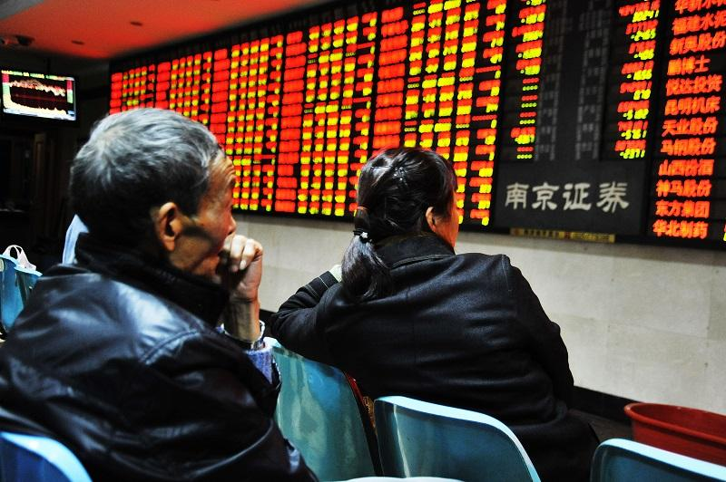 nvestors observe stock market at a stock exchange hall on Nov. 23, 2015 in Nanjing, Jiangsu Province of China. The Shanghai Composite Index dropped 20.18 points or 0.56%,  to close at 3,610.32 points.