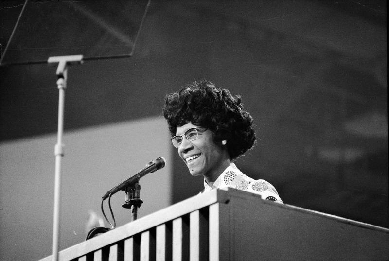 U.S. Congresswoman Shirley Chisholm speaks at a podium at the Democratic National Convention, Miami Beach, Florida, July 1972.