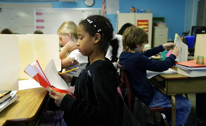 In this photo taken April 18, 2014, students in a fourth-grade classroom at Olympic View Elementary School in Lacey, Wash. use upright file folders to shield their papers during an exam.