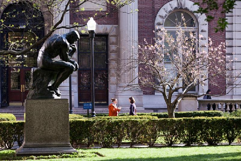 Students chat on campus at Columbia University in Morningside Heights in Upper Manhattan, on May 6, 2015 in New York, N.Y.
