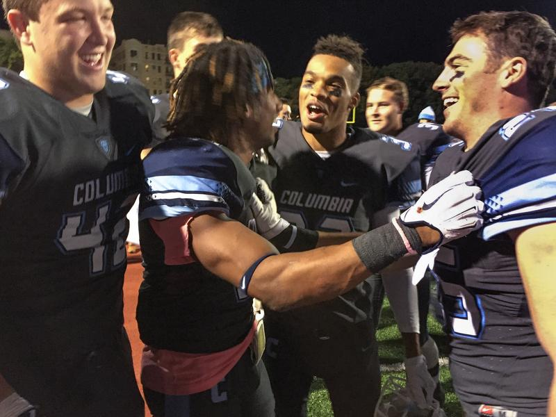 Co-captain Cameron Molina, center, celebrates with teammates after Saturday's game against the Wagner College Seahawks.