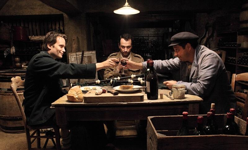 "August Diehl as ""Hans"" (left), Matthew Rhys as ""Percy"" (center), and Laurent Gerra as ""Albert"" (right) in Come What May directed by Christian Carion."