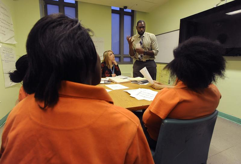Brooklyn, NY - 01/20/15 - Bellevue Hospital Center psychologist Isaiah Pickens works with girls at Crossroads Juvenile Center.