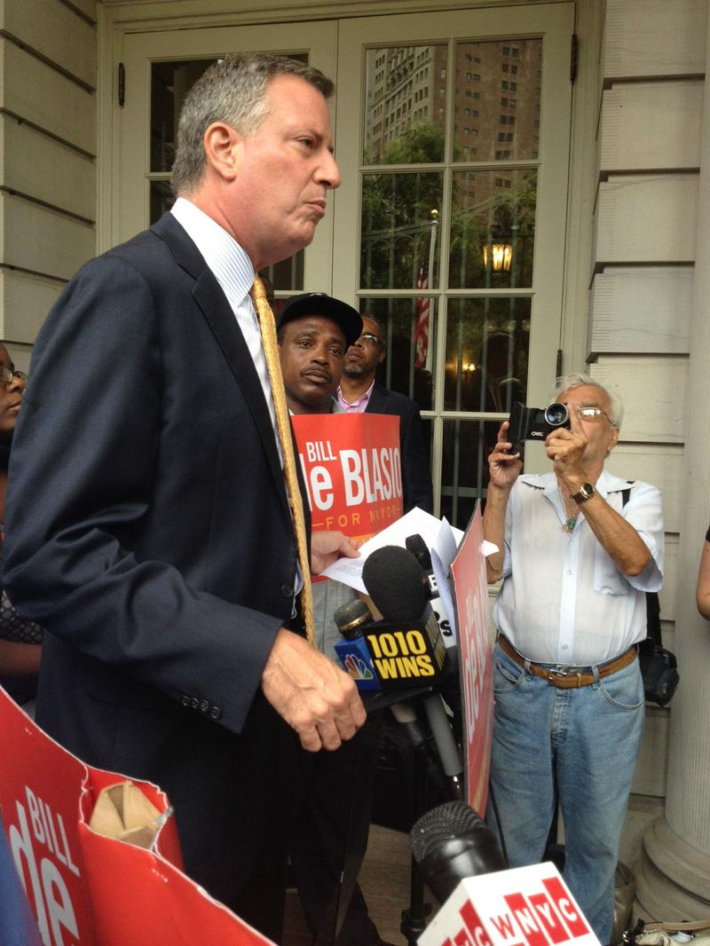 De Blasio started his public schedule with a press conference at City Hall, where he called for the council to override Bloomberg's veto on two bills to create greater oversight for the NYPD.