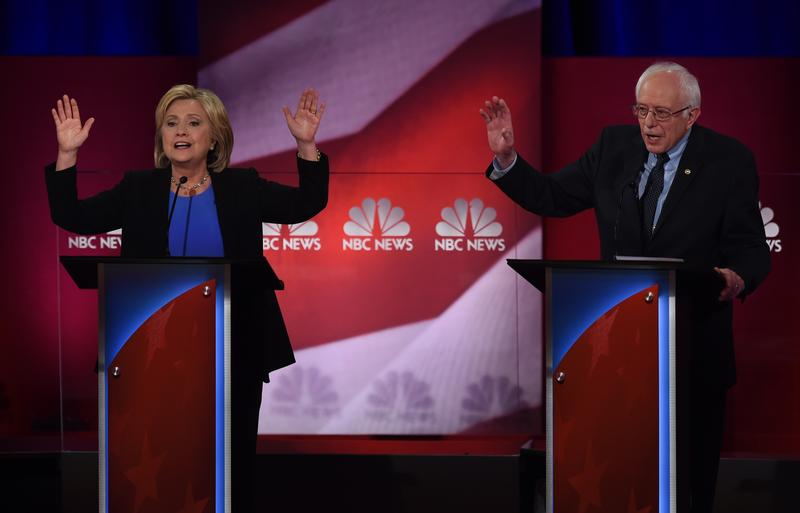 Democratic presidential candidates Hillary Clinton (L) and Bernie Sanders (R) participate in the NBC News-YouTube Democratic Candidates Debate on January 17, 2016 in Charleston, South Carolina.