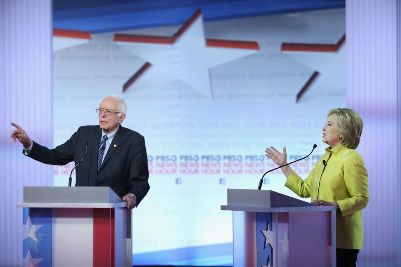 Democratic presidential candidates Senator Bernie Sanders and Hillary Clinton participate in the PBS NewsHour Democratic debate at the University of Wisconsin-Milwaukee on February 11, 2016.