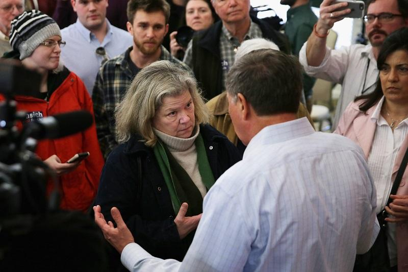 GOP presidential candidate Ohio Gov. John Kasich talks to voters -- some of them undecided about who they will vote for -- at the end of a town hall meeting at the Portsmouth Country Club 2/1/16.