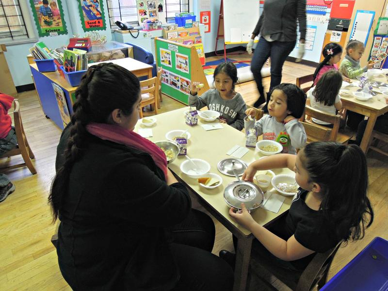 Students eat breakfast in a pre-k class run by the Children's Aid Society.