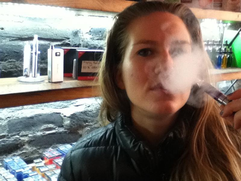 Talia Eisenberg, co-founder of the e-cigarettte brand Henley Vapor, demonstrates the technology that helped her quit smoking at her flagship store in SoHo.