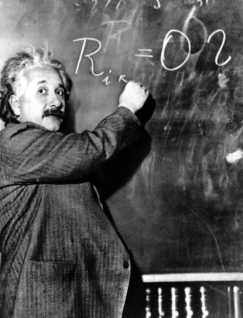 Dr. Albert Einstein writes out an equation for the density of the Milky Way on the blackboard at the Carnegie Institute, Mt. Wilson Observatory headquarters in Pasadena, Calif., on Jan. 14, 1931.