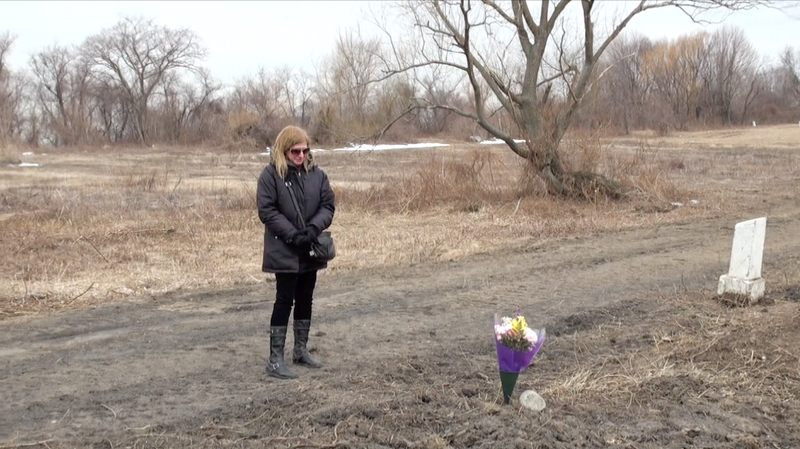 Elaine Joseph visits the graveside of her daugther, Tomika, in February 2014.