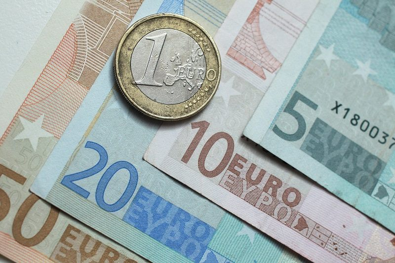 In this photo illustration, a one Euro coin lies on Euro currency bills on June 21, 2011 in Berlin, Germany.