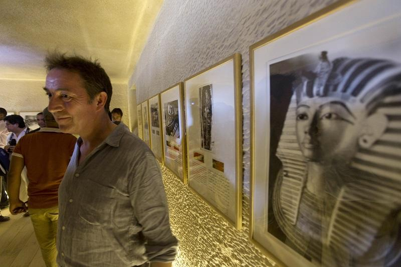 Adam Lowe, director of Factum Arte, Madrid, welcomes guests at the opening of an exact replica of the Tomb of Tutkankhamun in Luxor, Egypt, Wednesday, April 30, 2014.