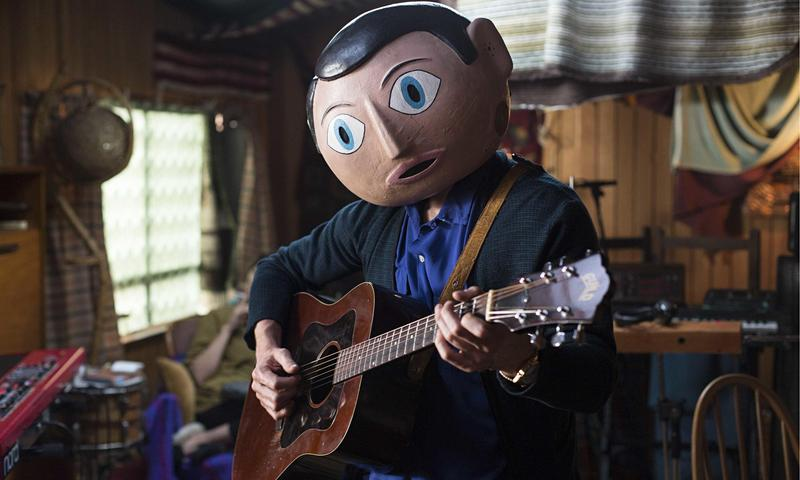 Michael Fassbender plays the papier-mâché mask-wearing Frank Sidebottom in the eccentric comedy 'Frank.'