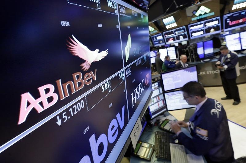 The ABInBev logo appears above the post where it trades on the floor of the New York Stock Exchange, Monday, Nov. 14, 2016.
