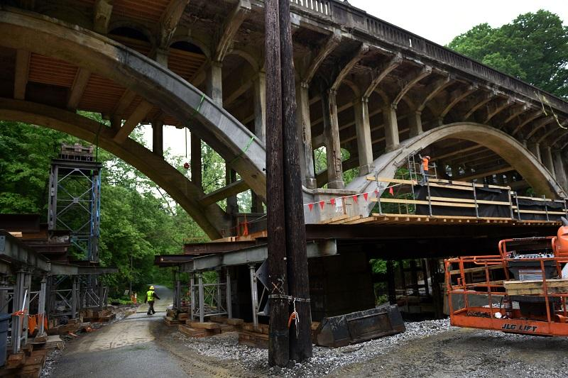 Construction workers repaired parts of the Sligo Creek Bridge in Takoma Park, Maryland on May 11, 2016. The bridge, originally built in 1932, is being replaced with the same graceful arches.