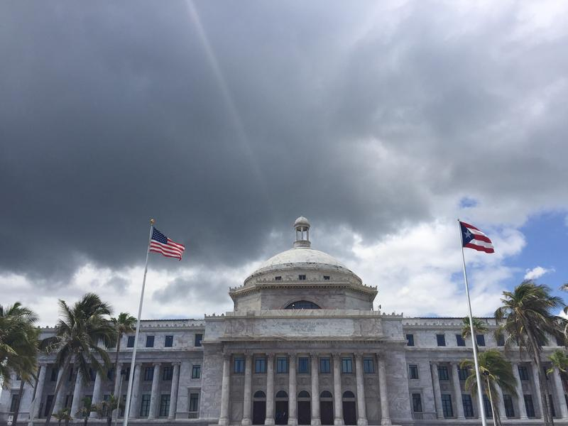 The US and Puerto Rican flags outside the capitol building in San Juan.