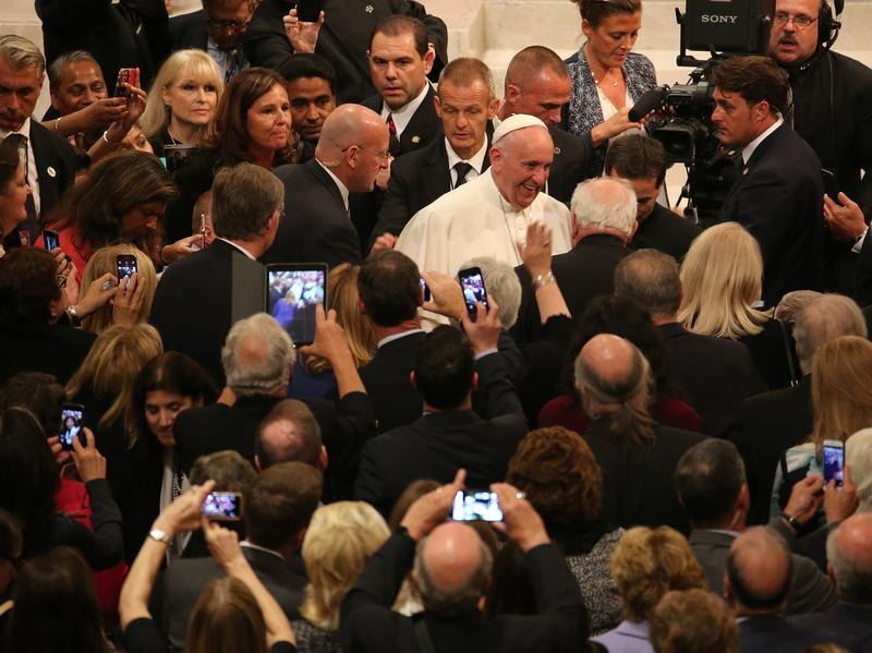 Pope Francis greets people as he leaves St. Patrick's Cathedral September 24, 2015 in New York City. The Pope is on his first trip to the United States, visiting Washington, DC, New York and Philadelp