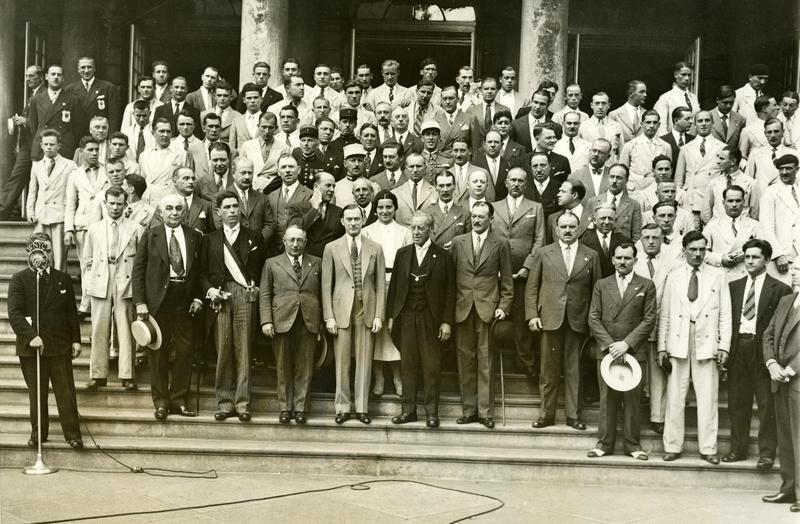 Mayor Walker welcomes French Olympic athletes on their way to Los Angeles Olympics, July 14, 1932. Note WNYC's Tommy Cowan at lower left.
