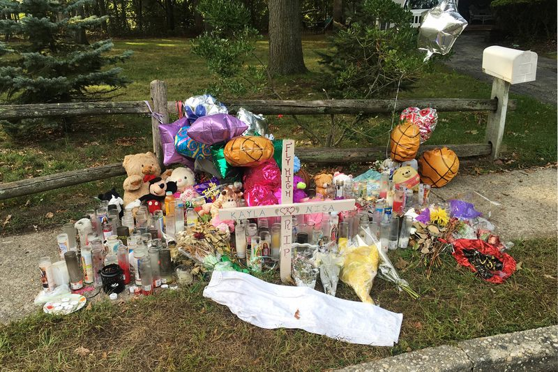 In this Sept. 27, 2016 file photo, a memorial to best friends Nisa Mickens and Kayla Cueva is seen near the spot where their bodies were found in Brentwood, N.Y.