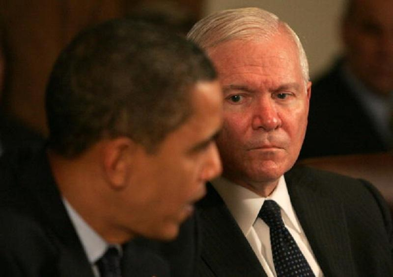 Secretary of Defense Robert Gates listens as U.S. President Barack Obama (left) speaks at a cabinet meeting at the White House on November 23, 2009 in Washington, DC.