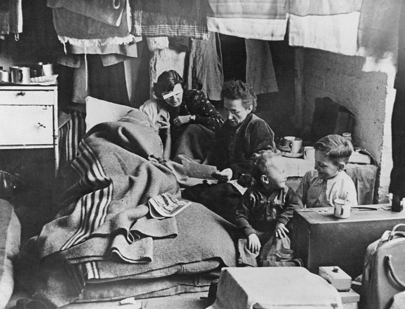 A family at a Durchgangslager or transit camp for Displaced Persons in West Berlin, 3rd February 1953.