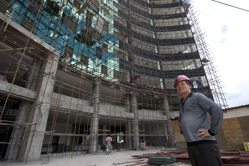 Chinese constructor Liou stands next to a site in Nairobi on May 13, 2014. Kenyan contractors are losing out to Chinese firms that are grabbing lucrative construction tenders for private projects.