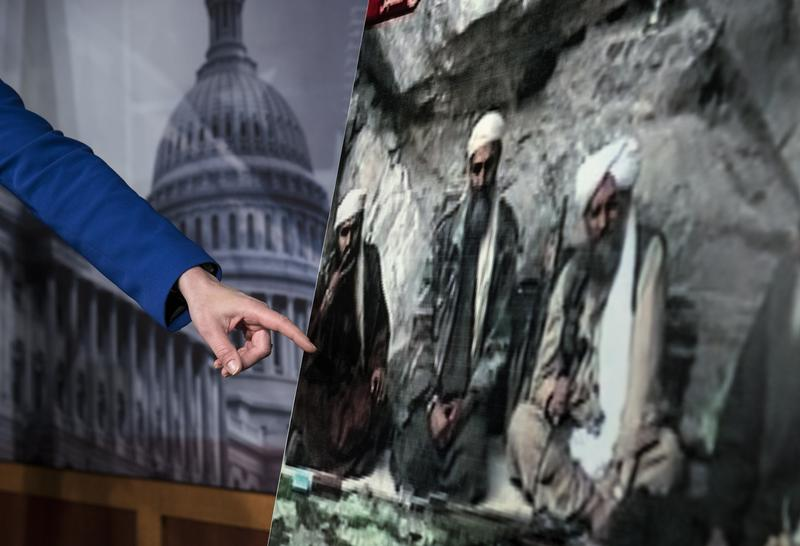 US Senator Kelly Ayotte points to a photo of Sulaiman Abu Ghaith (L) during a press conference on Capitol Hill on March 7, 2013 in Washington, DC.