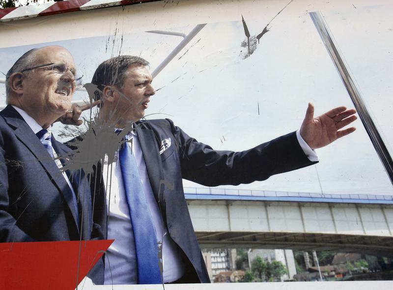 Pre-election billboard splattered with paint, showing Rudy Giuliani and Serbian Progressive Party deputy leader Aleksandar Vucic who ran for Belgrade mayor.