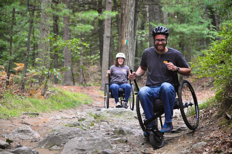 Benjamin Judge, co-founder of GRIT, and Tish Scolnik testing prototypes of the Freedom Chair on a local mountain biking trail.
