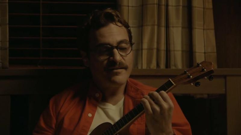 "Joaquin Phoenix plays the ukulele while singing ""The Moon Song,"" a song written by Karen O for the film 'Her.'"