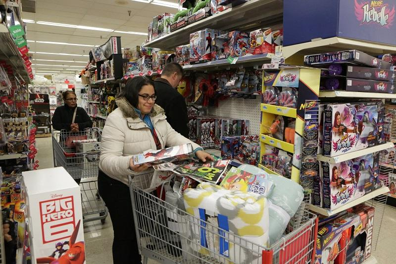 Kmart customers in Chicago are first to shop holiday doorbuster deals on Thursday, Nov. 26, 2015. Kmart opened at 6 a.m. on Thanksgiving Day.