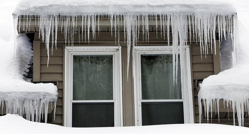 In this Feb. 4, 2015 file photo, icicles hang from a home in Sutton, N.H.