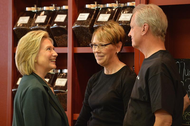 Democratic Presidential hopeful and former US Secretary of State, Hillary Clinton greets JP and Jennifer Howard, owners of Tremont Grille.