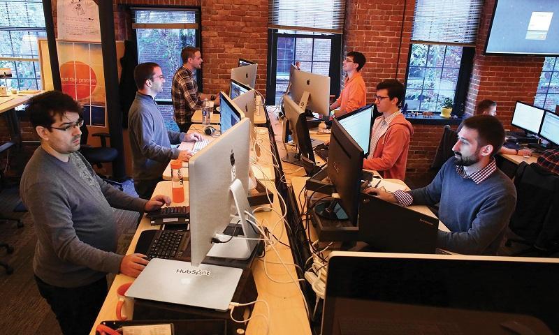 HubSpot employees work at their standing desks, on Monday, October 27, 2014.