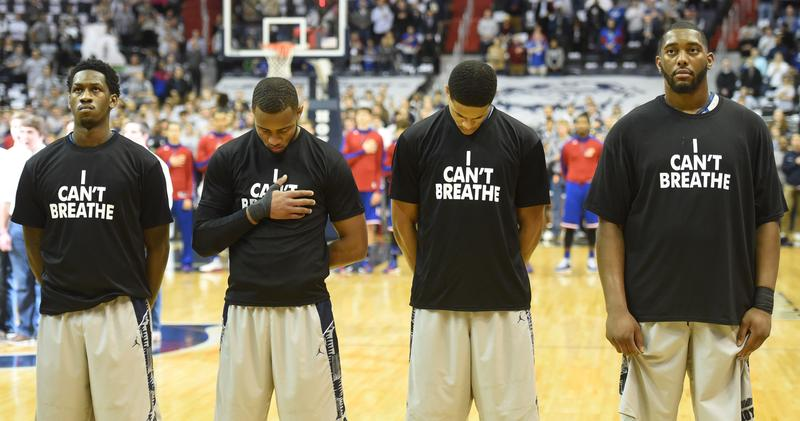 Members of the Georgetown University basketball team line up for the national anthem wearing 'I Can't Breathe' t-shirts to honor Eric Garner, who died while being placed in a police chokehold.