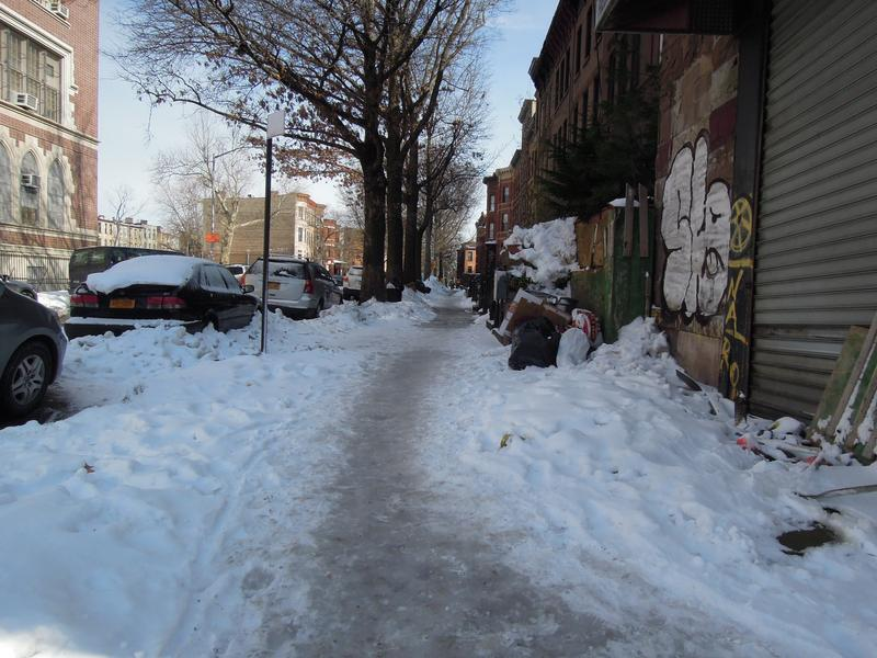 Icy sidewalks can be treacherous to navigate, like this one in Bedford-Stuyvesant, Brooklyn.
