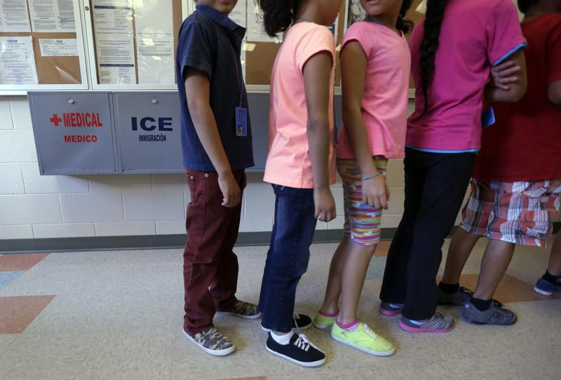 In this file photo, detained immigrant children line up in the cafeteria at the Karnes County Residential Center in Karnes City, Texas.