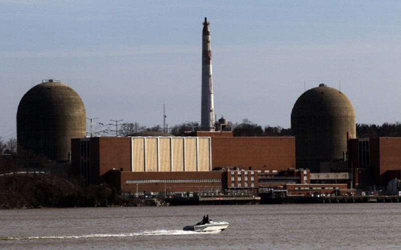A boat moves along the Hudson River in front of the Indian Point nuclear power plant on March 18, 2011 in Buchanan, New York.