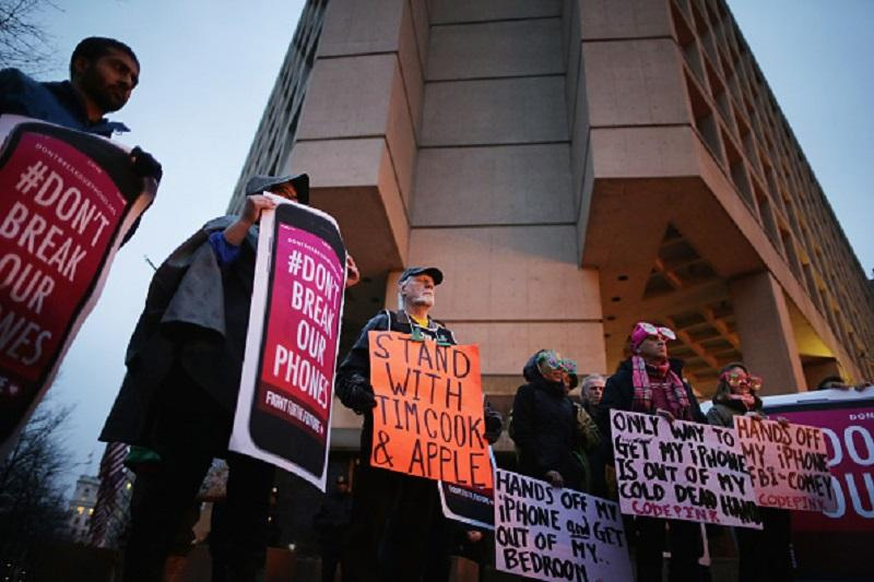 Organized by Fight for the Future, about a dozen protestors demonstrate outside the Federal Bureau of Investigation's J. Edgar Hoover headquarters in support of Apple.
