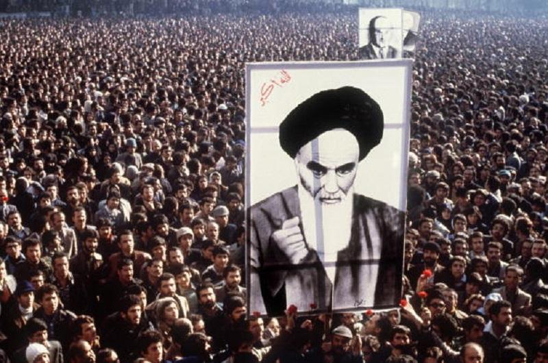 In a file picture taken in January 1979, Iranian protestors hold a up a poster of Ayatollah Ruhollah Khomeini during a demonstration in Tehran against the Shah.