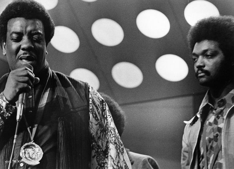 (L-R) Gospel singer Reverend James Cleveland and Reverend Jesse Jackson perform onstage at the PUSH 'Save The Children' concert in a film still from the 1973 movie of the same name.