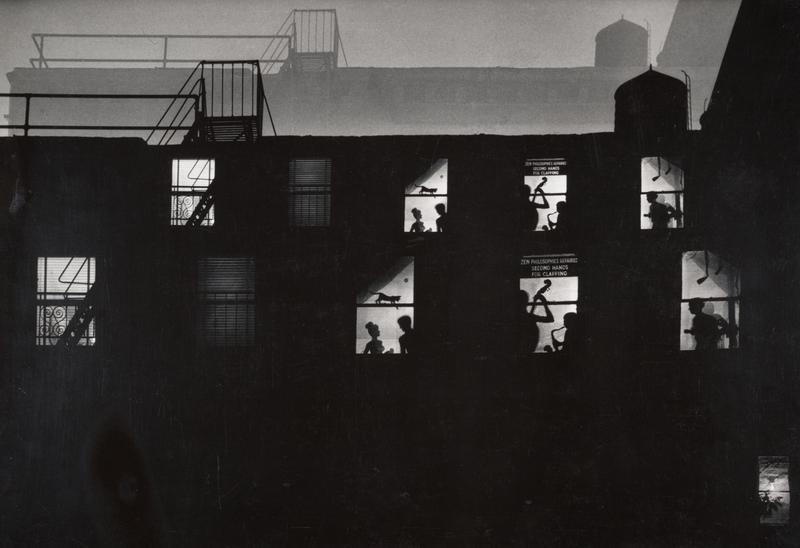 Always doing something creative, W. Eugene Smith put cut-out silhouettes into the windows of his loft on 6th Avenue to create these illusions for people looking in from the outside.