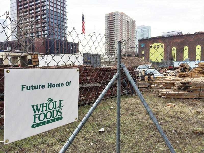 A fake sign fooling Jersey City residents into thinking a Whole Foods is coming to Warren and Bay streets. There is, however, a Whole Foods moving into Newark.