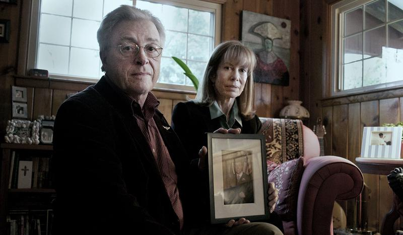 Jim Cagey and Anne Roberts with a photo of their son Patrick at their Lexington, Kentucky home.
