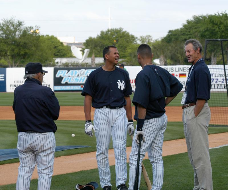Former catcher and manager Yogi Berra #8, thirdbaseman Alex Rodriguez #13, shortstop Derek Jeter #2, of the New York Yankees, speak with commentator and former pitcher Jim Kaat, from the YES Network.