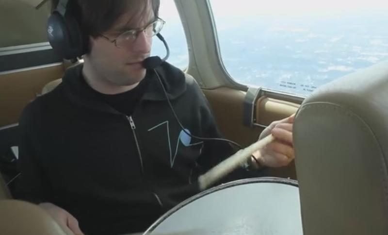 Kid Millions (aka John Colpitts), air-drumming, from a 4-seater plane