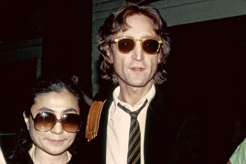 Former Beatle John Lennon and his wife Yoko Ono pose for a portrait outside of the Times Square recording studio 'The Hit Factory' before a recording session of his final album 'Double Fanasy' 8/1980